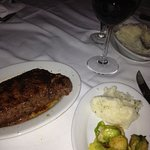Ruth's Chris steak, mashed potoates, brussel sprouts and wine