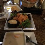 clam chowder, house salad and fresh bread with seasoned oil