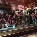 Instead of giving pagers to waiting diners, bobble head characters are given out.