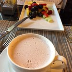 Hot chocolate & fruit for breakfast at Cafe des Architectes