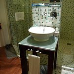 shower and toilet inside glass enclosure, sink in room