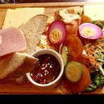 Ploughman's plate - homemade bread and butter (large square on right side), fresh salads.
