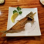 The chef fileted the whole fish for a perfect nigiri, then fried the bones for a crispy finish.