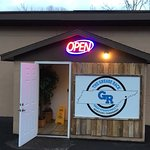 Made changes to entry. New sign w logo, new open sign, new door that opens outward as it should