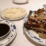 Shredded duck with pancakes