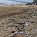 Don't expect a clean beach at Kuta. Be adventurous and head north or south to another beach.