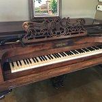 Gorgeous 19th century piano on display