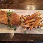 Lunch menu, local artists paintings, my Guinness, my wine, my pork sandwich