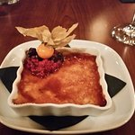 creme brulee with gooseberry and red berry garnish