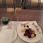 I was brought a complimentary plate of fruit and truffles as well as two glasses of champagne.