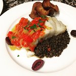 Roasted fillet of haddock, braised lentils, pepperonata, parsnip crisps