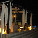 Poolside seating area at night