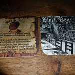 Beer mats description of the history of the Inn