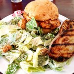 Grilled Chicken Sandwich with caesar salad and grilled potato