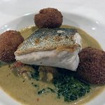 Fillet of hake, spiced fish cakes, greens, Goan curry, cray fish