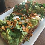 avocado toast with a Poached Egg and toasted almond slivers