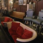 comfy chairs --> church pew --> barber chairs along back wall