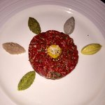 Beautiful steak tartare, one of their signature dishes and is amazing!
