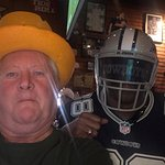 Cowboy sneaks up on a Packer