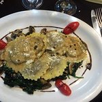 Mushroom pasta on spinach