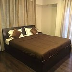 A large bed room, for our corporate guests is made keeping in mind the luxury.