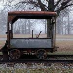 old car near tracks