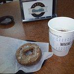 black coffee wwth a glazed coffee flavored donut.