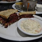Excellent hot pastrami with potato salad a side