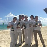 "This is teh adorable beach staff announcing it is ""Champagne O'Clock"" on the beach!"