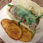 Chicken & Broccoli Rabe w/ Melted Provolone and our specialty Potato Medallions
