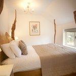Romantic luxury with the Exbury Room. Hand made oak bed. Balcony, Lounge area.