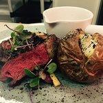 Beef rib eye with baked potatoe and beef glaze