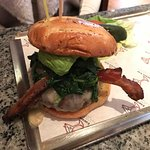 """This """"build your own"""" burger offers crispy bacon, lettuce and spinach."""