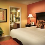 Master bedroom with adjoining bath at Williamsburg Plantation Resort
