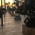 Dali statutes and on the horizon the sunset over the Moroccan coastline in the distance.  Simply