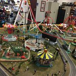 Kids can run each of the rides on this amusement park exhibit