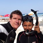 Me and my son snorkeling for the first time.
