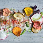 Snapper Crudo sliced radish, dill, pickled cucumber, jalapeno, beet chips, spring onions, espele