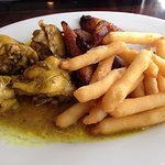curry chicken with yucca fries and plantains