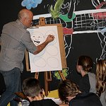 Cartoonist Paul Harvey delights the museum audience during the 2017 school holiday program.