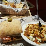 pulled pork sandwich and small traditional poutine