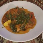 Tasty salmon in a spinach sauce