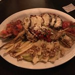 antipasto - grilled artichokes and red pepper, bruschetta, apple slices with walnuts and honey