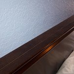 Dust on the head board. As well as other areas of the room.