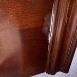mold growing in the crack on the headboard.