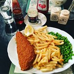 Solid fish and chips. Great customer service!