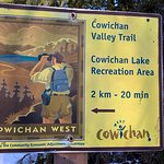 Cowichan Valley Trail sign post along the trail