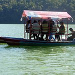 Boat with tourists on way to temple