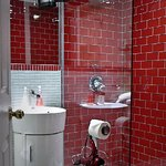 We loved the bright red tiles in the compact but well appointed bathroom.
