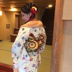 wife in kimono at ryokan entrance